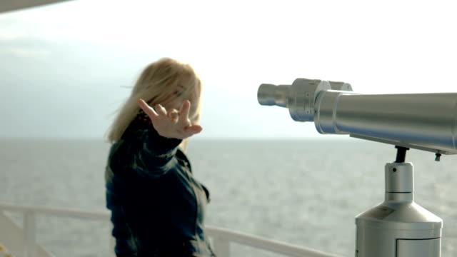 Woman standing on deck of  ship, enjoying holidays, travel. Slow motion. HD