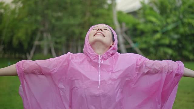SLO MO Woman standing outside in summer rain