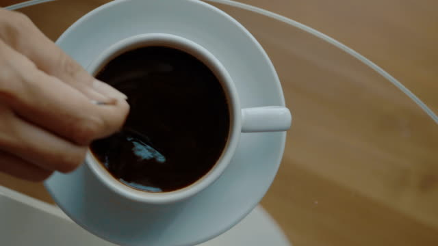 Woman stirring coffee video