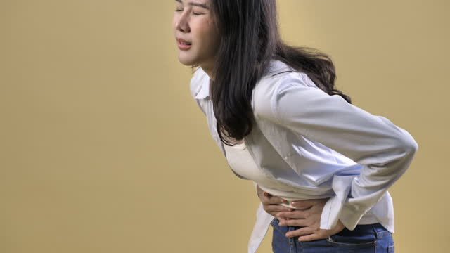 Woman stomach pain pain isolated on clean background