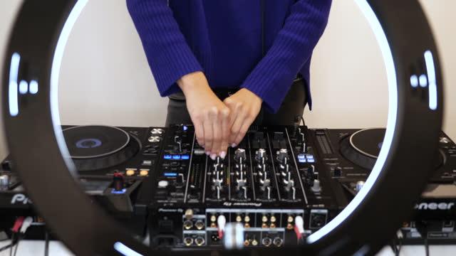 Woman streaming DJ set online video