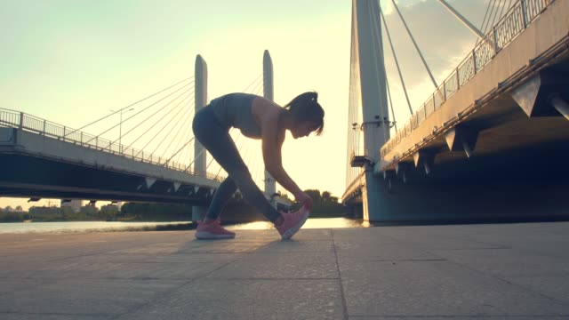 Woman stretching exercise outdoors in the morning