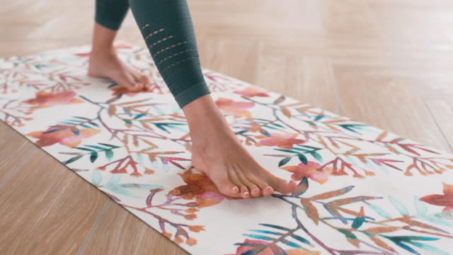 woman stretching on gym mat - metodo pilates video stock e b–roll