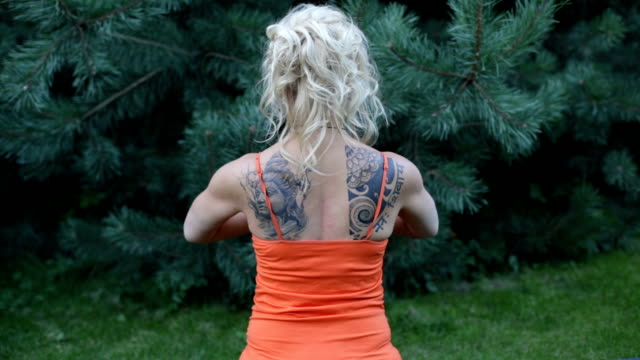 woman stretching shoulders Close up outdoor workout - woman stretching shoulders, view from the back human joint stock videos & royalty-free footage