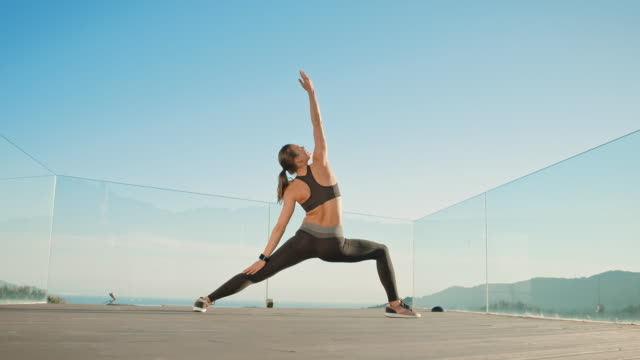 woman stretching - flessibilità video stock e b–roll