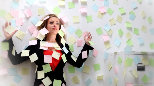 Woman stuck to wall with notes