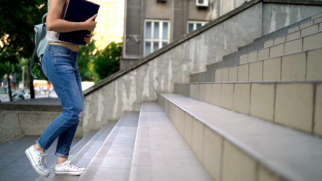 Woman student climbing stairs