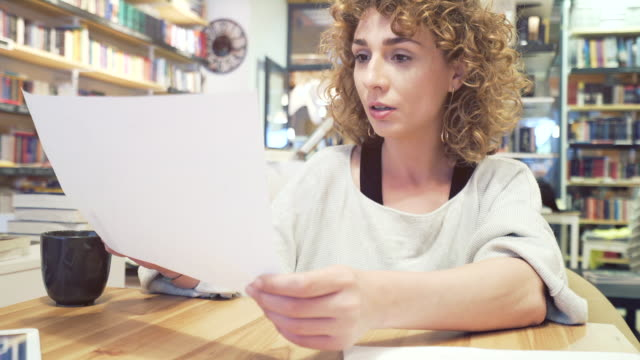 woman studying. - paragone video stock e b–roll