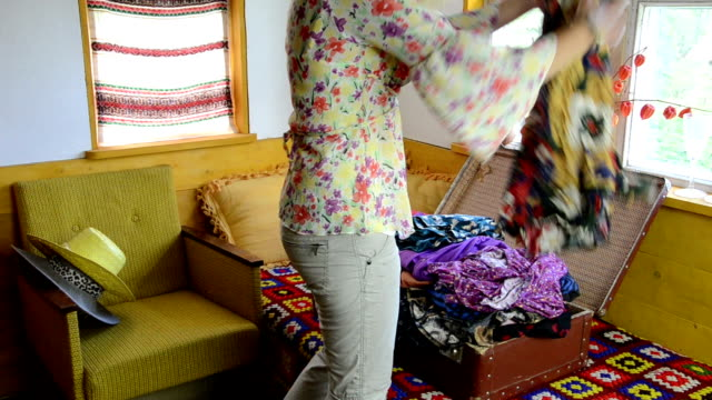 woman suitcase full cloth video