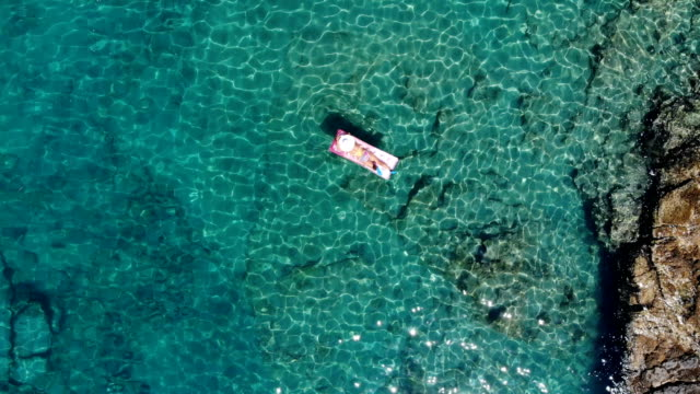 woman sunbathing on seabed. - fethiye video stock e b–roll