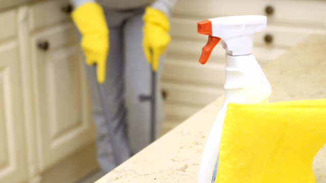 woman sweeps kitchen floor - disinfectant stock videos & royalty-free footage
