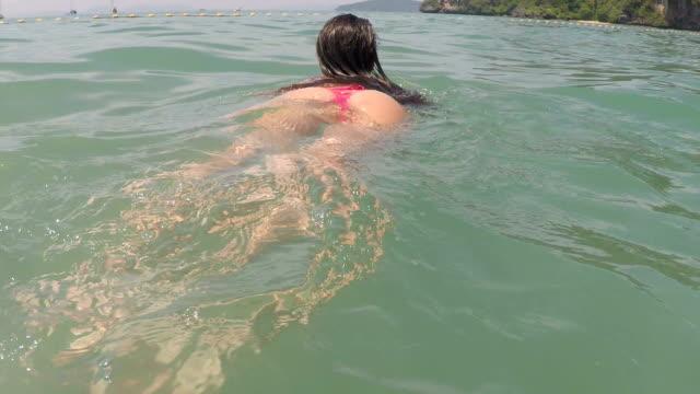 Woman Swimming In Water On Sea Beach Top View POV Young Tanned Girl In Bikini video
