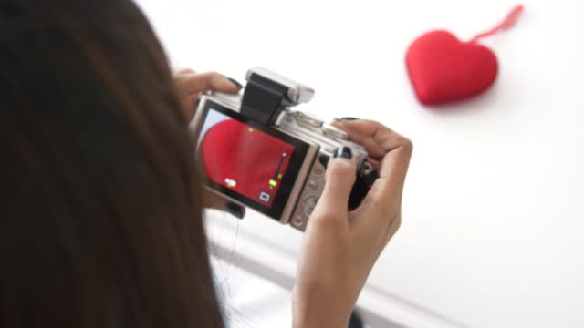 woman take a picture of heart with her leisure activity at her room