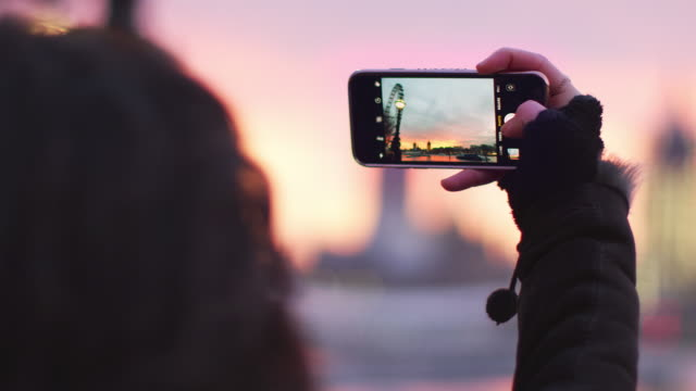 Woman Takes Photo Of Big Ben On Mobile Phone At Sunset video