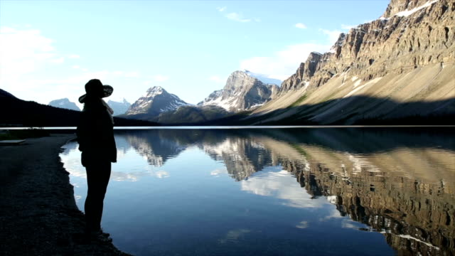 woman takes picture of mountain lake - canada travel stock videos and b-roll footage