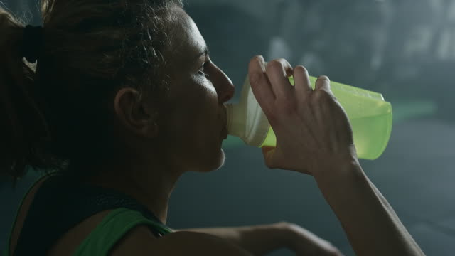 Woman taking a break after a tough training session video