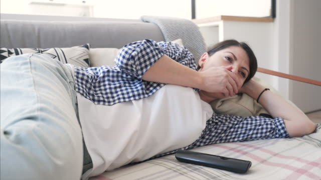 Woman taking a nap while watching TV. video