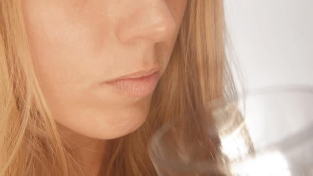 Woman taking a pill, Global Pharmacies video
