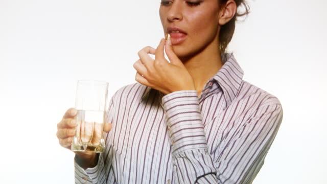 HD: Woman Taking a Pill video