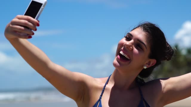 woman taking a selfie at beach - south america travel stock videos and b-roll footage