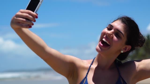Woman taking a selfie at Beach video