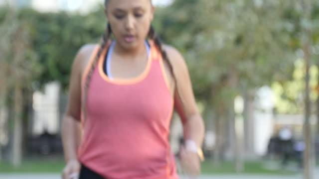 Woman taking break after running workout