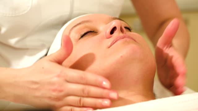 Woman taking facial treatments at beauty spa video