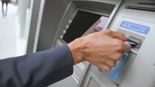 ld woman taking her bank card and money from the atm - banks and atms stock videos & royalty-free footage