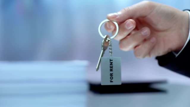 Woman taking keychain from hand, accommodation for rent, real estate business Woman taking keychain from hand, accommodation for rent, real estate business car rental stock videos & royalty-free footage