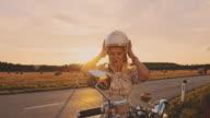 istock SLO MO Woman taking off a helmet 1197890847