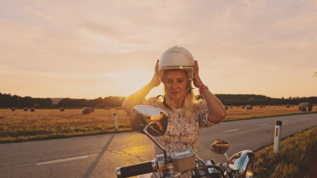 SLO MO Woman taking off a helmet