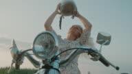 istock SUPER SLO MO Woman taking off a helmet 1197949650
