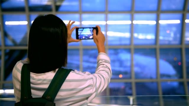 Woman taking photo on phone