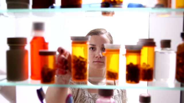 Woman taking pill with water  pill stock videos & royalty-free footage