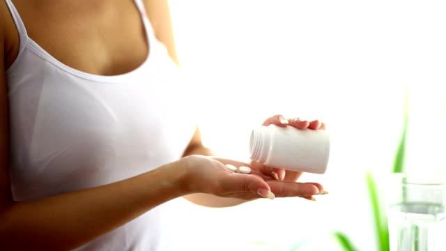 Woman taking pills. video