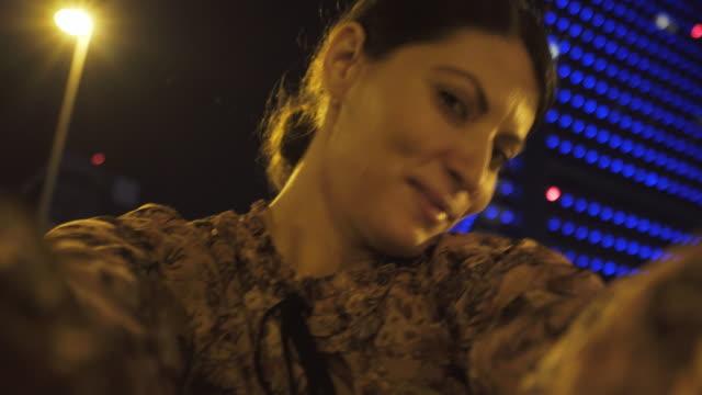 Woman taking selfie. video