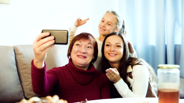 woman taking selfie with her  daughter and granddaughter video