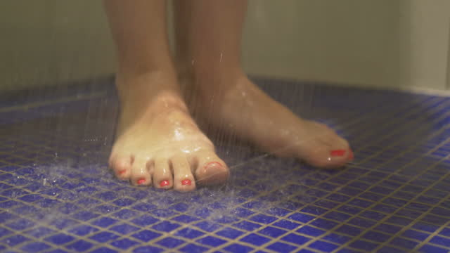 Woman taking shower in 4k slow motion 60fps video