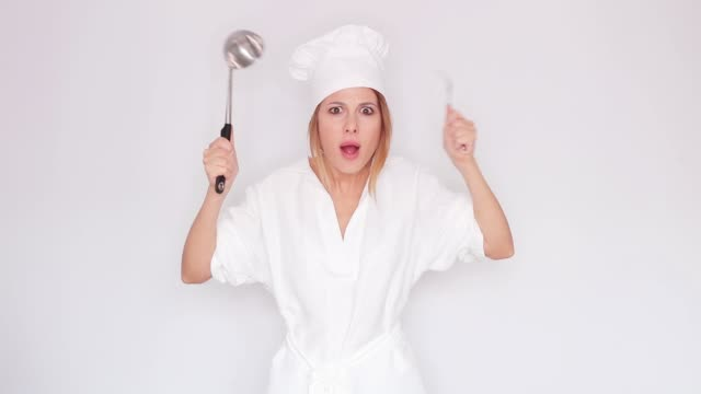 woman talking and holding kitchenware video