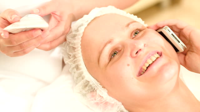 Woman talking on the phone at beauty spa video