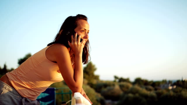 Woman talking on the phone video