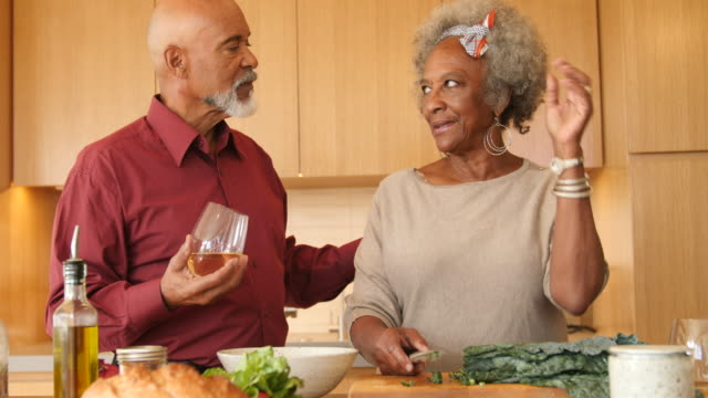 Woman talking to man while preparing brunch at home