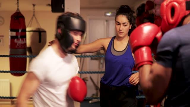 Woman Teaching Men to Box video