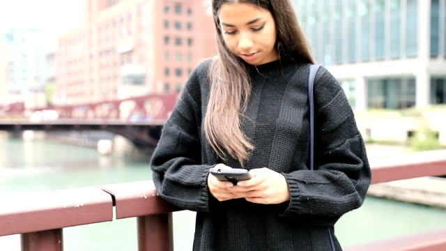 Woman teen in Chicago downtown having fun waiting for friends video