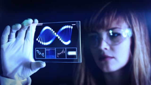 woman the scientist is analysing structure dna. - bio tech stock videos and b-roll footage