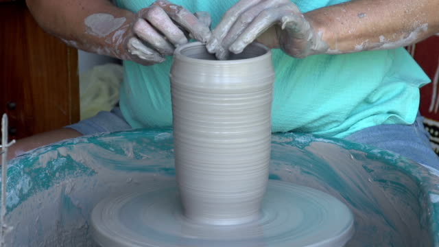 Woman throwing a pot on a potter's wheel,Cape Town, South Africa video