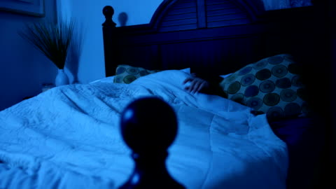 Woman tossing and turning in her bed under the moonlight ALT Woman tossing and turning in her bed under the moonlight ALT fear stock videos & royalty-free footage