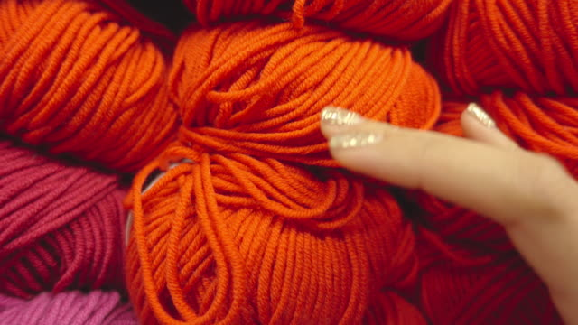 woman touching ball of wool close up shot video