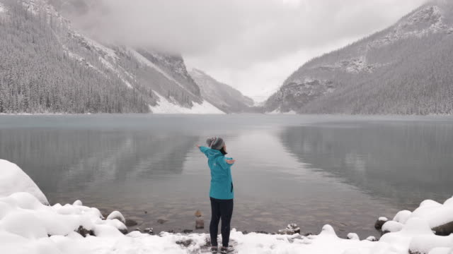 Woman Tourist outstretched hand in lake louise video