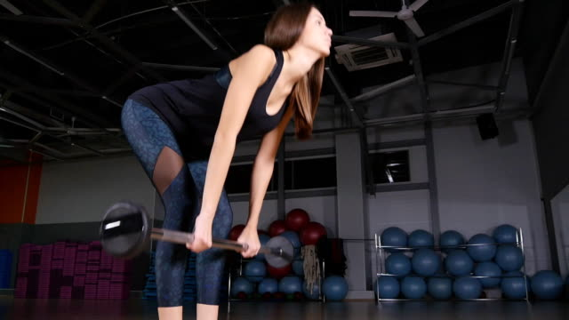 Woman training deadlift at gym video